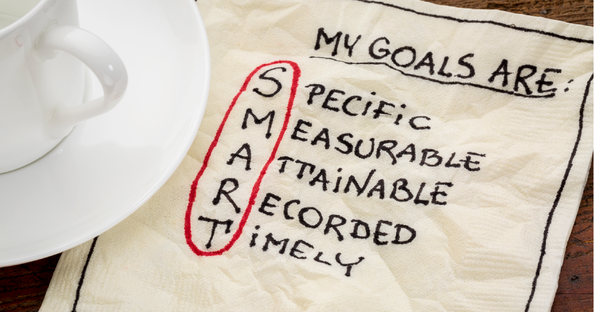 Using SMART goals to re-evaluate marketing goals on a paper napkin
